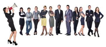 Affärskvinnor med megafonen som framme står av andra affärspersoner Royaltyfri Fotografi