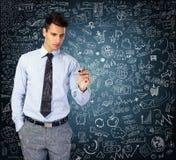 Affärsmän som drar affärsstrategi Arkivbild