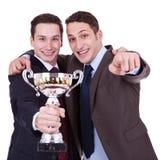 affärsmän som pekar till att segra dig Royaltyfria Foton