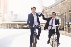 Affärsmän som rider cyklar royaltyfria bilder