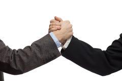 Affärsmän som skakar händer som isoleras på vit Arkivfoton