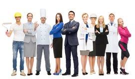 Affärsman över olika yrkesmässiga arbetare royaltyfria foton