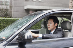 Affärsman Driving Car Royaltyfri Bild
