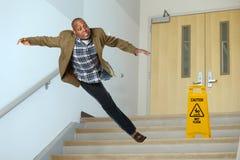 Affärsman Falling på trappuppgång royaltyfria foton