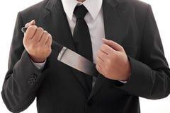 Affärsman Holding Knife som är klar att anfalla den isolerade begreppsmässiga bilden Royaltyfri Fotografi