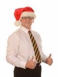 Affärsman i den Santa hatten Royaltyfria Foton