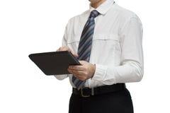 Affärsman i den vita skjortan med en minnestavla Fotografering för Bildbyråer