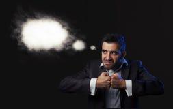 Affärsman i dräkten som den är ilsken royaltyfria foton