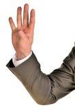 Affärsman i dräktshower fyra fingrar Royaltyfri Bild