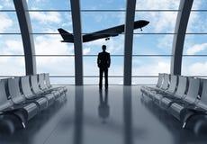 Affärsman i flygplats arkivbild