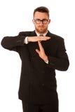 Affärsman i formell dräkt som gör en gest tid som isoleras ut arkivbilder