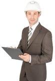 Affärsman i hållare för hjälminnehavpapper Royaltyfri Fotografi