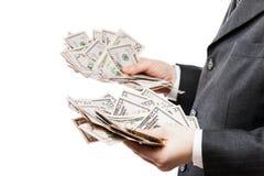 Affärsman i pengar för valuta för US dollar för svart dräkthand hållande Arkivbild