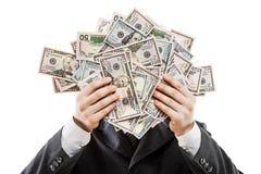 Affärsman i pengar för valuta för US dollar för svart dräkthand hållande Royaltyfria Bilder