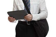 Affärsman med bandet som rymmer PC för en portfölj och minnestavla Arkivbilder