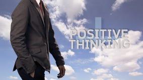 Affärsman med begrepp av positivt tänka arkivbild