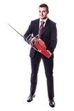 Affärsman med chainsawen Arkivbild