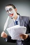 Affärsman med clownframsidan Arkivbilder