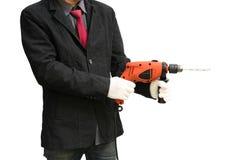 Affärsman med den elektriska drillborren royaltyfria foton
