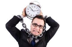 Affärsman med den isolerade klockan Fotografering för Bildbyråer