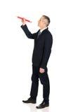 Affärsman med den stora röda blyertspennan Arkivbilder