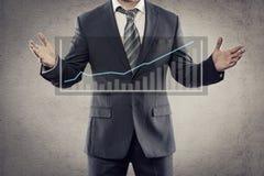Affärsman med diagrammet Fotografering för Bildbyråer