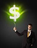 Affärsman med en ballong för dollartecken Arkivfoton