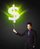 Affärsman med en ballong för dollartecken Fotografering för Bildbyråer
