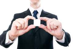 Affärsman med en kub i händerna Royaltyfri Bild
