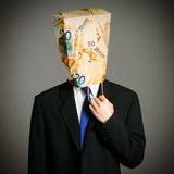 Affärsman med en pappers- påse på huvudet arkivfoton