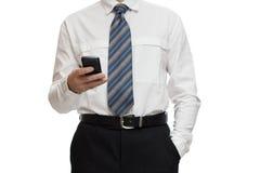Affärsman med en smartphone Fotografering för Bildbyråer
