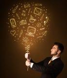 Affärsman med en social massmediaballong Arkivbilder