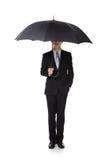 Affärsman med ett paraply Arkivbild