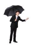 Affärsman med ett paraply Fotografering för Bildbyråer