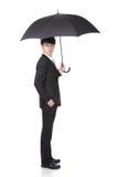 Affärsman med ett paraply Arkivfoton