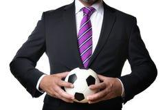 Affärsman med fotbollbollen Royaltyfri Foto