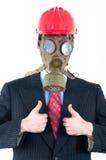 Affärsman med gasmasken och hjälmen Royaltyfria Bilder