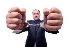 Affärsman med handbojor Arkivfoto