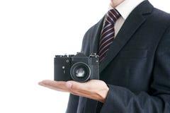 Affärsman med kameran Fotografering för Bildbyråer