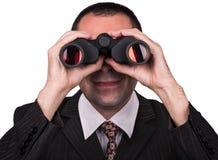 Affärsman med kikare Fotografering för Bildbyråer