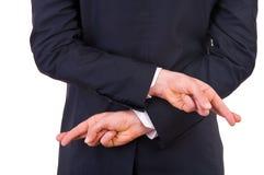 Affärsman med korsade fingrar. Royaltyfri Foto