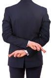 Affärsman med korsade fingrar. Royaltyfri Bild
