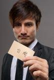 Affärsman med kortet arkivfoton