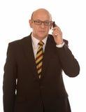 Affärsman med mobil Fotografering för Bildbyråer