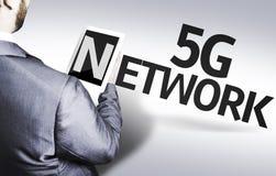 Affärsman med nätverket för text 5G i en begreppsbild Arkivfoto