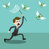 Affärsman med netto försöka för fjäril att fånga pengar Arkivbild