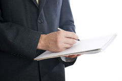 Affärsman med pennan och notepaden Royaltyfri Bild