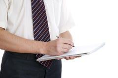 Affärsman med pennan och notepaden Arkivfoton