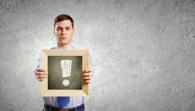 Affärsman med ramen Arkivbild