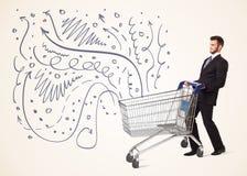 Affärsman med shoppingvagnen Arkivfoton